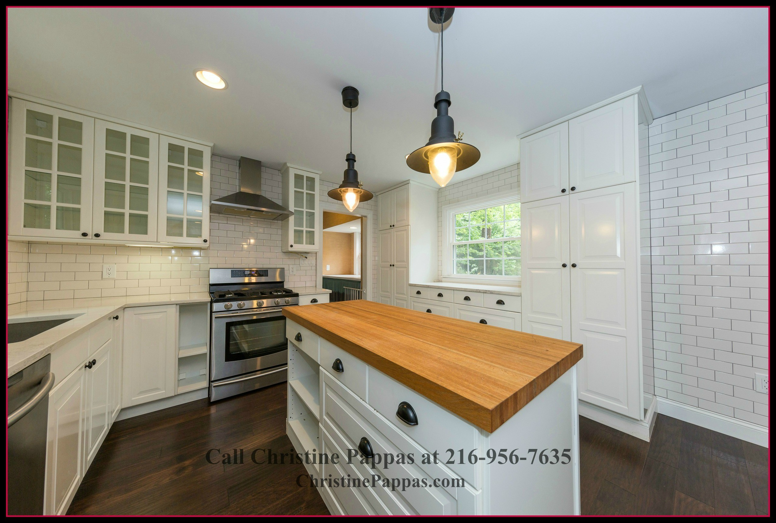 The gourmet kitchen in this strikingly beautiful home for sale in Gates Mills OH features center island and built in cabinets that add up to the elegance of the interiors.