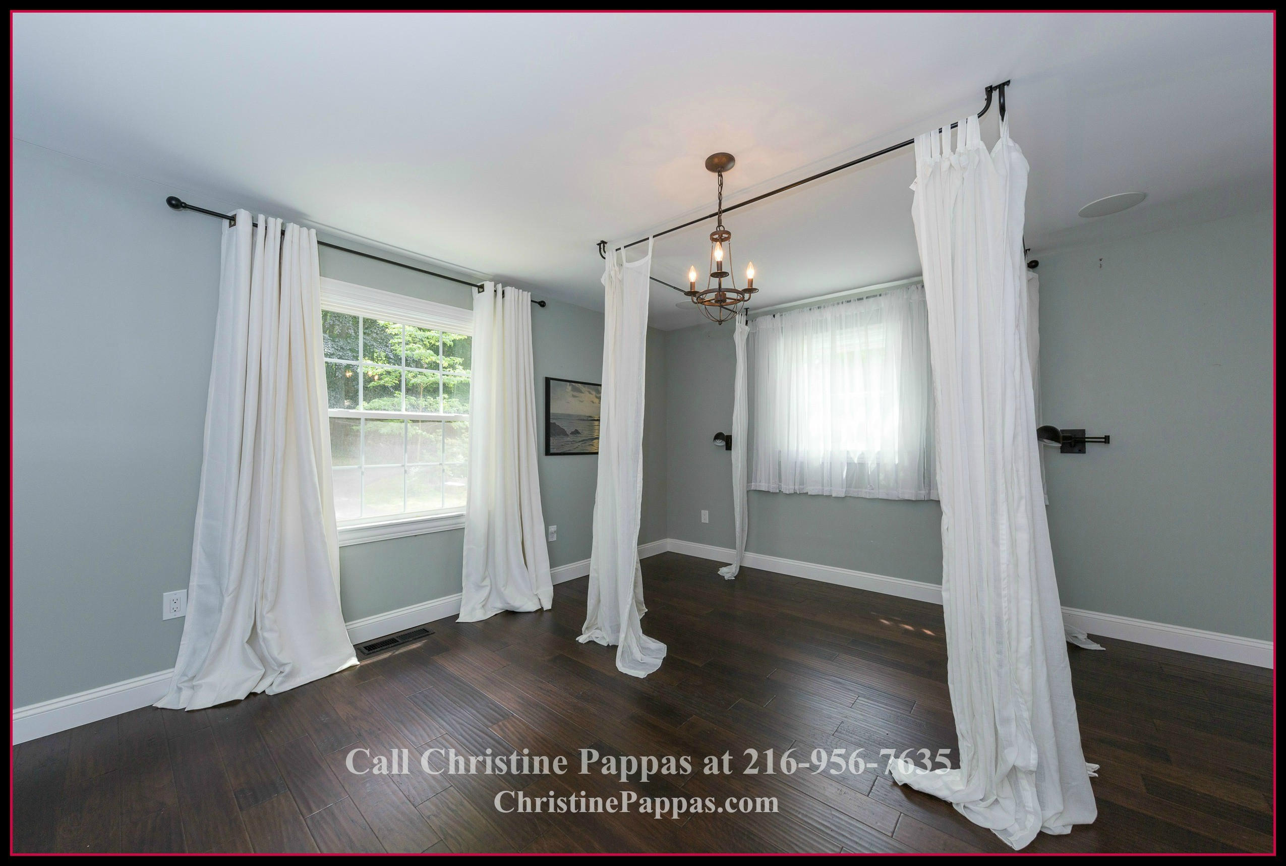 Enjoy memorable family time in the expansive master bedroom of this beautiful home for sale in Gates Mills OH.